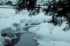 Ice little river in snow. Frozen little river in snow Royalty Free Stock Image