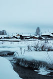 Ice little river in snow. Frozen little river in snow royalty free stock photography