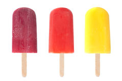 Ice lollies. Three different flavored ice lollies over a white background Royalty Free Stock Photo