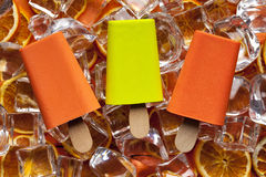 Ice lollies and ice cubes. Three ice lollies and ice cubes Royalty Free Stock Photos