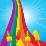 Ice lollies on a rainbow and blue sky Royalty Free Stock Photos