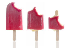Ice lollies. Set of bitten ice lollies in a row Stock Photography
