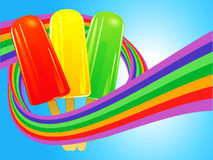 Ice lollies wrapped in a rainbow over blue sky Royalty Free Stock Photos