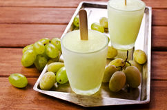 Ice lolly of green grapes. On a wooden background. Selective focus Stock Photo