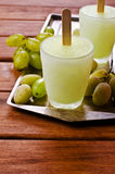 Ice lolly of green grapes. On a wooden background. Selective focus Royalty Free Stock Photo