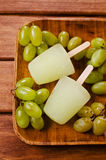 Ice lolly of green grapes. On a wooden background. Selective focus Stock Photography