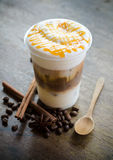Ice macchiato coffee. On wooden table Stock Image