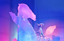 Ice Art bear and penguin looking at each other. Ice Magic, Sculpture, Ice Art bear and penguin looking at each other royalty free stock photos