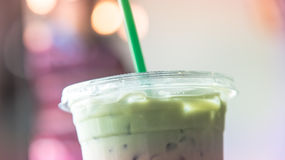 Ice matcha latte cup in cafe pastel tone Stock Photos