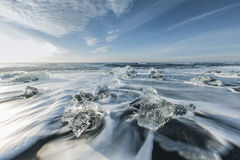 Ice melting on the beach Stock Photos
