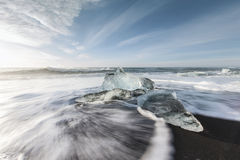 Ice melting on the beach Stock Images