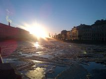 Ice is melting on the Fontanka river in St.Petersburg stock photo
