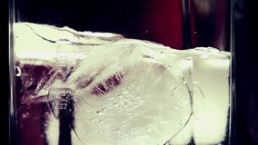 Ice Melting in a Glass Timelapse Closeup Footage stock video footage