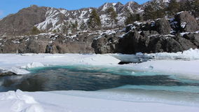 Ice melting on the mountain river in the early spring,Altai, Russia stock footage