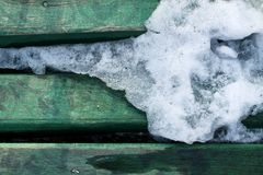 Ice melting on wood texture Royalty Free Stock Photos