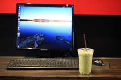 Ice milk Green tea with Desktop computer Stock Photography