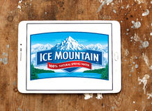 Ice mountain mineral water company logo. Logo of ice mountain mineral water company on samsung tablet on wooden background stock photo