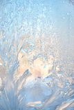 Ice natural background. Frosty pattern at a winter window glass Stock Photos