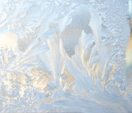 Ice natural background. Frosty pattern at a winter window glass Royalty Free Stock Image