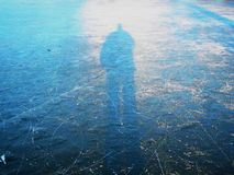 Ice the outline of a man sun beautiful winter day. To spend it at the rink love the winter the snowboard or skis and all currents can skate Royalty Free Stock Photo