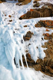 Ice over rocks wall on Baikal lake at winter. Time Royalty Free Stock Images