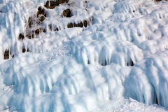 Ice over rocks wall on Baikal lake at winter. Time Stock Photography