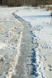 Ice path on frozen lake Stock Photo