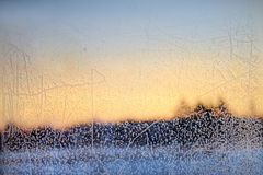 Ice pattern and sunlight on winter glass Royalty Free Stock Images