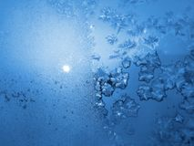 Ice pattern and sunlight on winter glass Royalty Free Stock Image