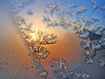 Ice pattern and sunlight on winter glass Stock Photography