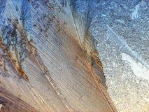 Ice pattern on the window. In winter stock photos