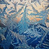 Ice Pattern on winter Glass in the frost at sunset. Ice Pattern on glass are shot in macro. Ice Pattern on glass look futuristic a royalty free stock image