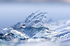 Ice patterns. Beautiful ice patterns. Close-ups on a blue backgroundice patterns Royalty Free Stock Image