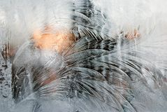 Ice patterns on glass. Close up of patterns formed by ice on glass surface Stock Photography