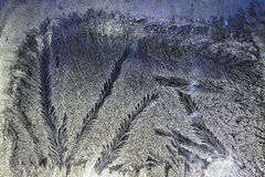 Ice patterns on glass Stock Photos