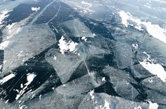 The ice of Lake Baikal. Frozen floes and cracks stock photo