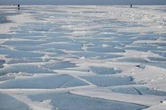 Lake Baikal in sunny winter day. Mirror surface, cracks and hummocks Royalty Free Stock Image