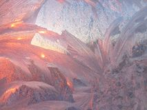 Ice patterns and morning sunlight Royalty Free Stock Photography