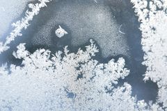 Ice patterns on the window during strong frost. Flowers, lines, crystals, ice rose, abstract pattern Royalty Free Stock Image