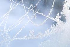 Ice patterns on the window during strong frost. Flowers, lines, crystals, ice rose, abstract pattern Stock Image