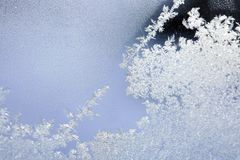 Ice patterns on the window during strong frost. Flowers, lines, crystals, ice rose, abstract pattern Stock Photography