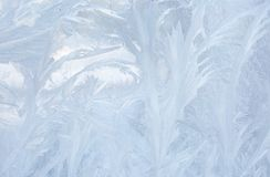 Ice patterns on winter glass. Christmas frozen background. Winter toning effect. Stock Image