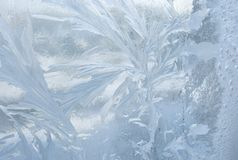 Ice patterns on winter glass. Christmas frozen background. Winter toning effect. Stock Photo
