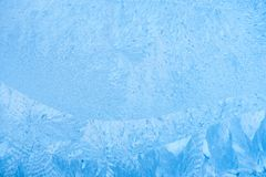 Ice patterns on winter glass, holiday background stock image