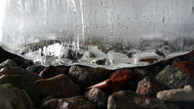 Ice. A piece of ice on the rocks stock photo