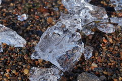 Ice pieces on the beach Stock Photos
