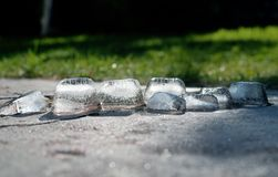 Chunks of ice melt and glisten in the sun stock image
