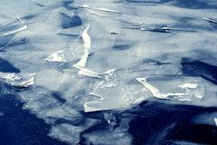 Ice pieces of frozen blue water. In winter Royalty Free Stock Image