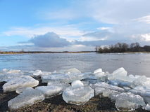 Ice pieces near river Stock Images