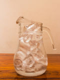 Ice pitcher. Glass jug with the ice Royalty Free Stock Images
